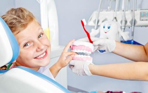 Kid smiling in Dental Chair